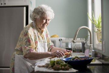 17512-an-elderly-woman-washing-produce-pv